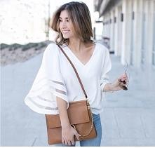 Elegancka bluzeczka damska z oryginalnymi, zdobionymi siateczką rękawkami. Pasuje do marynarki czy sweterka. Kliknij w zdjęcie i sprawdź, gdzie można ją kupić :)