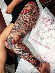 dragon thigh tattoo