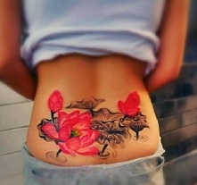 lotus lower back tattoo
