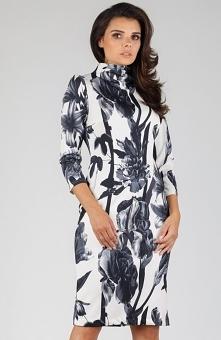 Nommo NA330 sukienka bloom Elegancka sukienka o pięknym kobiecym fasonie, wykonana została z przyjemnego materiału, który świetnie wygląda na sylwetce, sukienka wykończona golfem