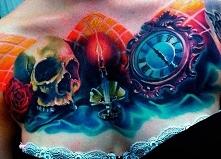 skull clock chest tattoo
