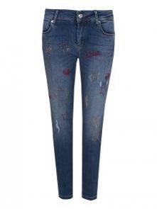 Potargane jeansy znawców mo...