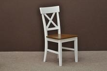 Krzesło drewniane białe na pewno przypadnie do gustu wielbicielom nowoczesneg...