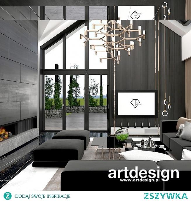 Fornir w oryginalnym, ciemnym odcieniu nadaje temu wnętrzu salonu elegancki charakter   CATCH THE WIND   Wnętrza domu