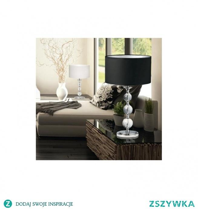 Nowoczesna lampa stołowa REA RLT93163-1B firmy Zuma Line to elegancka i stylowa lampa w kolorze czarnym. Wykonana z metalu, kryształu i tkaniny posiadająca jedno źródło światła o mocy max 60W. Lampa stołowa REA charakteryzuje się wyjątkowym Designem, którą można zakupić w dwóch kolorach czarnym i białym. Kolekcja REA Zuma Line posiada również model lampy stojącej w kolorach czarny i biały.