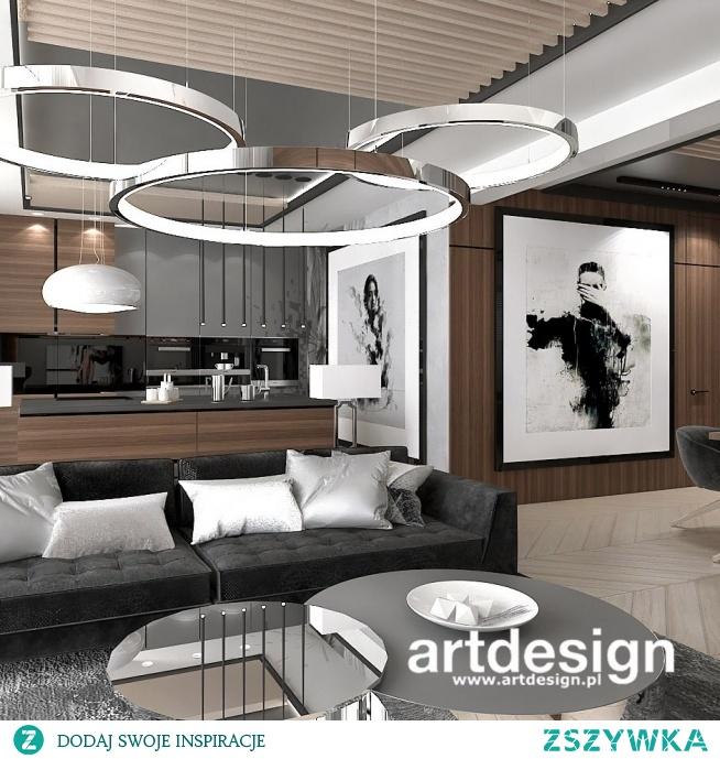 Pokój dzienny z kuchnią w apartamencie. Fornir o pięknej fakturze, szarości i biel tworzą nowoczesną i przytulną całość.