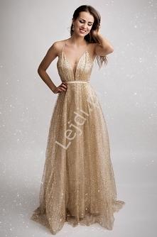 Długa brokatowa suknia z tr...