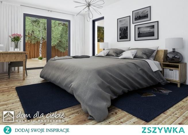 Pogodna to projekt optymalnego domu jednorodzinnego dla 3-4osobowej rodziny. Strefa wejściowa przed domem oraz dwustanowiskowy garaż stanowią spójna całość w strefie wejściowej. Budynek ozdobiony jest detalami w naturalnych kolorach - cegłą oraz jasnym drewnem. W środku zaprojektowano trzy sypialnie, przestronną przestrzeń salonu, kuchni i jadalni. Widok sypialni.