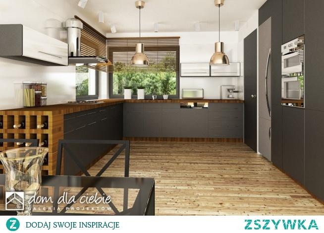 Pogodna to projekt optymalnego domu jednorodzinnego dla 3-4osobowej rodziny. Strefa wejściowa przed domem oraz dwustanowiskowy garaż stanowią spójna całość w strefie wejściowej. Budynek ozdobiony jest detalami w naturalnych kolorach - cegłą oraz jasnym drewnem. W środku zaprojektowano trzy sypialnie, przestronną przestrzeń salonu, kuchni i jadalni. Widok kuchni.