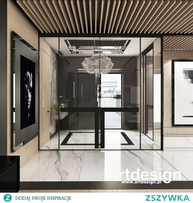 Hol wejściowy to bardzo ważne miejsce w domu. Elegancki przedpokój jest wizytówką mieszkania, a oddzielając go szklanymi drzwiami, otwieramy go na widok na salon. | POWER OF DESIGN | Wnętrza domu