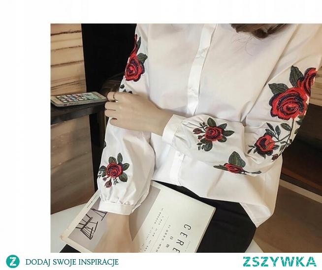 Elegancka damska koszula z haftowanymi rękawami. --> sprawdź