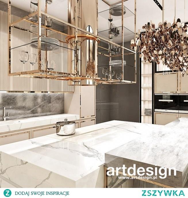Piękna kuchnia z wyspą, elegancką zabudową meblową i dekoracyjnym okapem | UNPARALLELED ELEGANCE | Wnętrza domu