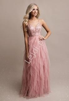 Długa suknia o oryginalnym ...