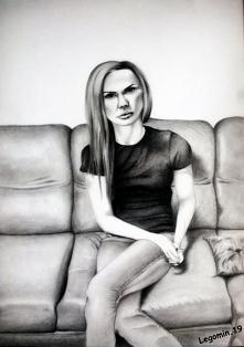 Portret dziewczyny, rysowany ołówkami miękkimi.