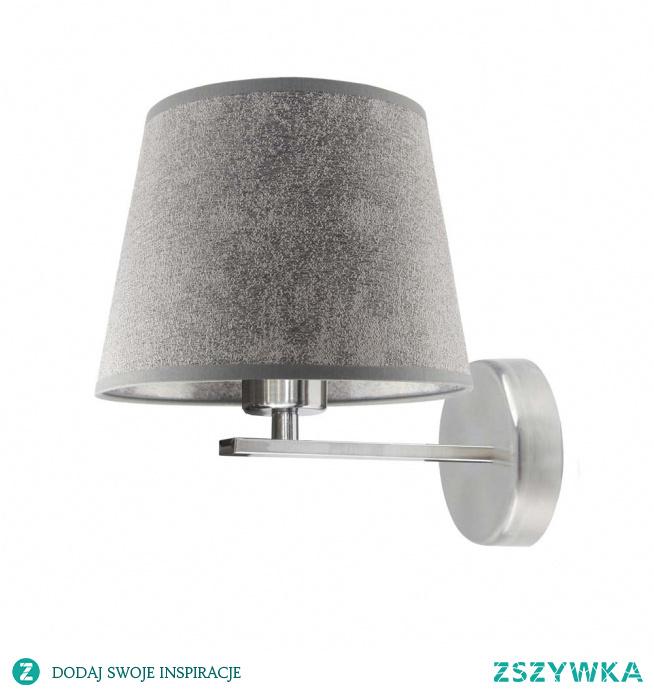 Przedstawiany kinkiet PUNA, będący składnikiem naszej oferty, znacznie wyróżnia się spośród innych propozycji oświetleniowych. Przyczynia się do tego przede wszystkim uroczy abażur, który w delikatny sposób zwęża się ku górze tworząc tym samym postać stożka. Atutem tej lampy jest również jej stabilny metalowy stelaż, wykonany z dbałością o każdy szczegół. Lampę charakteryzuje minimalistyczny, świeży design, który nie obfituje w zbędne elementy, które mogłyby przyczynić się do zakłócenia harmonii panującej we wnętrzu.  Kinkiet PUNA dostępny jest w kilkunastu wariantach kolorystycznych abażuru: biały, ecru, jasny szary, miętowy, musztardowy, jasny różowy, jasny fioletowy, beżowy, szary (stalowy), czerwony, niebieski, fioletowy, zielony butelkowy, granatowy, grafitowy, brązowy, czarny oraz szary melanż (tzw. beton), oraz kilku kolorach stelaży: biały, czarny, chrom, stal szczotkowana, stare złoto.