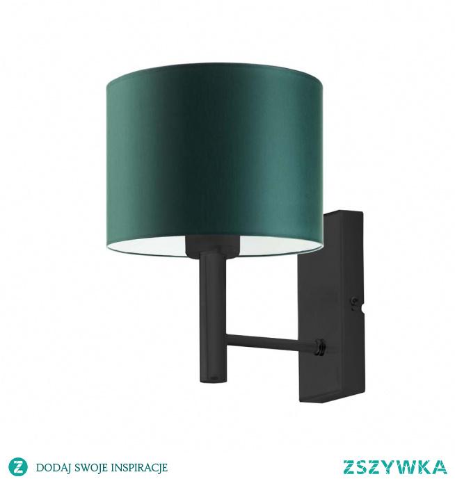 Kinkiet TEGU to kwintesencja elegancji w każdym calu! Lampę wzbogaca, atrakcyjny abażur w kształcie walca, dostępny w aż kilkunastu kolorach do wyboru. Lampa przyda się szczególnie jako doświetlenie trudno dostępnych miejsc w salonie, sypialni oraz pokoju dziennym. Kinkiet przywodzi na myśl wystrój wnętrz o charakterze glamour, klasyczny tkaninowy abażur stanowi zwieńczenie geometrycznego prostego stelaża, który swym designem rezprezentuje współczesny minimalistyczny styl. Oświetlenie idealnie wyglądać będzie nad szafką nocną w naszej sypialni oraz doskonale rozpromieni kącik kawowy w salonie lub pokoju dziennym.  Kinkiet TEGU dostępny jest w kilkunastu wariantach kolorystycznych abażuru (biały, ecru, jasny szary, miętowy, musztardowy, jasny różowy, jasny fioletowy, beżowy, szary (stalowy), czerwony, niebieski, fioletowy, zielony butelkowy, granatowy, grafitowy, brązowy, czarny oraz szary melanż (tzw. beton)) oraz kilku kolorach stelaży (biały, czarny, stal szczotkowana, stare złoto).