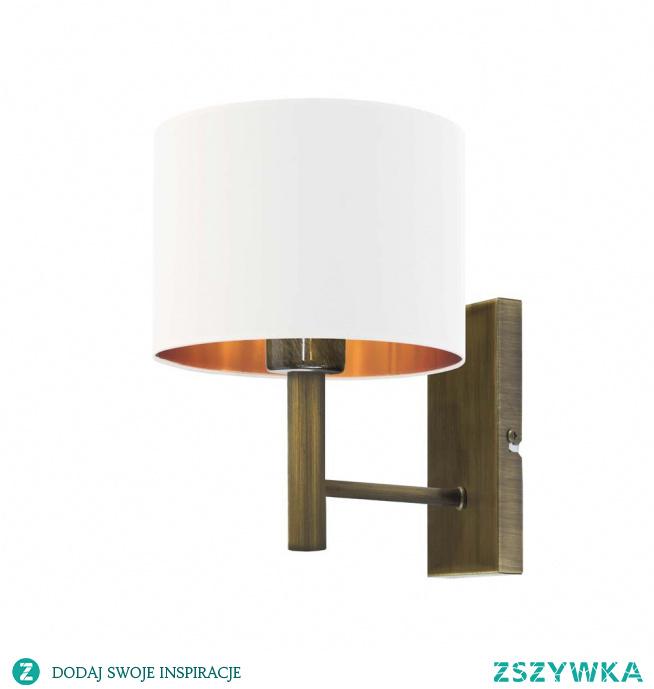 Kinkiet TEGU GOLD to kwintesencja elegancji w każdym calu! Lampę wzbogaca, atrakcyjny abażur w kształcie walca, dostępny w kilku kolorach do wyboru. Lampa przyda się szczególnie jako doświetlenie trudno dostępnych miejsc w salonie, sypialni oraz pokoju dziennym. Kinkiet przywodzi na myśl wystrój wnętrz o charakterze glamour, klasyczny tkaninowy abażur stanowi zwieńczenie geometrycznego prostego stelaża, który swym designem reprezentuje współczesny minimalistyczny styl. Oświetlenie idealnie wyglądać będzie nad szafką nocną w naszej sypialni oraz doskonale rozpromieni kącik kawowy w salonie lub pokoju dziennym.  Kinkiet TEGU GOLD dostępny jest w 5 wariantach kolorystycznych abażuru (biały ze złotym wnętrzem (złoty połysk), szary stalowy ze złotym wnętrzem (złoty mat), zieleń butelkowa ze złotym wnętrzem (złoty mat), granatowy ze złotym wnętrzem (złoty mat) oraz czarny ze złotym wnętrzem (złoty mat) oraz kilku kolorach stelaży (biały, czarny, stal szczotkowana, stare złoto.