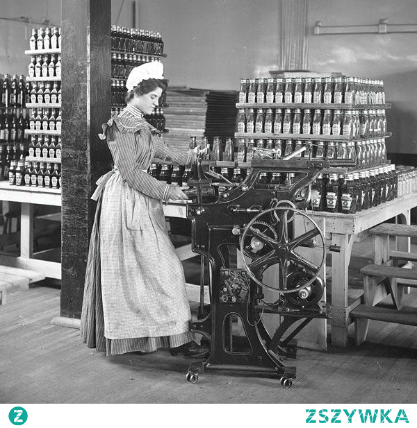Female worker bottling ketchup at the original Heinz factory circa 1897