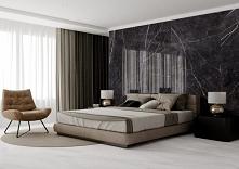 Nowoczesny salon ze ścianą wykończoną ciemnym marmurem i dużym łóżkiem.
