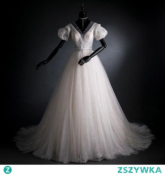 Eleganckie Kość Słoniowa Z Koronki Kwiat Suknie Ślubne 2021 Princessa V-Szyja Rękawy z dzwoneczkami Bez Pleców Trenem Sweep Ślub