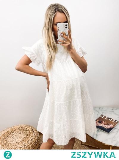 Sukienka Belize w drobne, ażurowe wzorki, w kształcie trapezu. Idealna na wyjście do miasta, zakupy lub spacery.